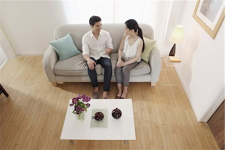 Couple chatting in living room Stock Photo - Premium Royalty-Free, Code: 614-06898597