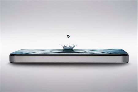 Smart phone with water crown droplet and ripple on screen Stock Photo - Premium Royalty-Free, Code: 614-06974081