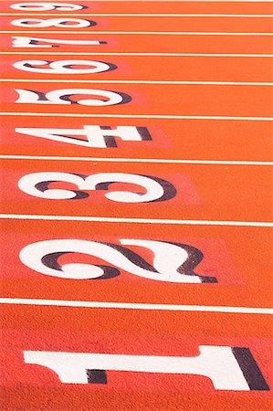 race track (people) - Numbers on running track in sportsground Stock Photo - Premium Royalty-Free, Code: 614-06974097