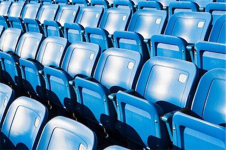 Empty blue seating in sports stadium Stock Photo - Premium Royalty-Free, Code: 614-06974099
