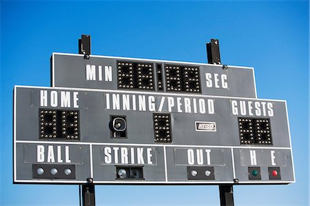 scoring - Baseball scoreboard against blue sky Stock Photo - Premium Royalty-Free, Code: 614-06974102