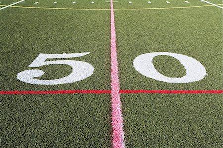 Fifty yard line on American football field Stock Photo - Premium Royalty-Free, Code: 614-06974103