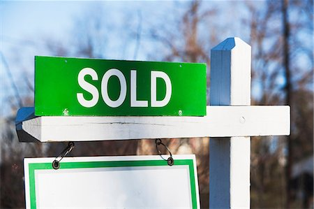 sold sign - Property sold sign, close up Stock Photo - Premium Royalty-Free, Code: 614-06974114