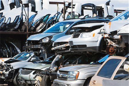 Cars stacked in scrap yard Stock Photo - Premium Royalty-Free, Code: 614-06974124