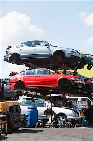 Cars stacked in scrap yard Stock Photo - Premium Royalty-Free, Code: 614-06974122