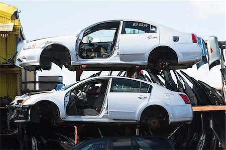 Cars stacked in scrap yard Stock Photo - Premium Royalty-Free, Code: 614-06974123