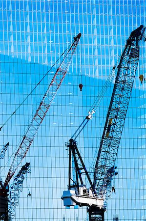 rectangle - Construction cranes in front of office building Stock Photo - Premium Royalty-Free, Code: 614-06974209