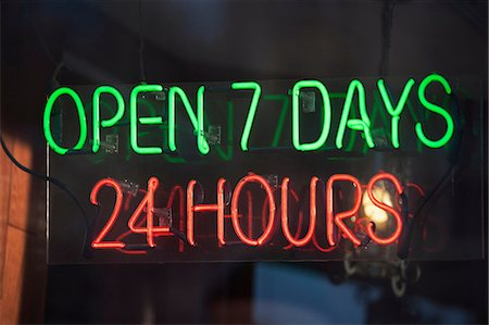 sign - 24 hour illuminated neon sign Stock Photo - Premium Royalty-Free, Code: 614-06974218