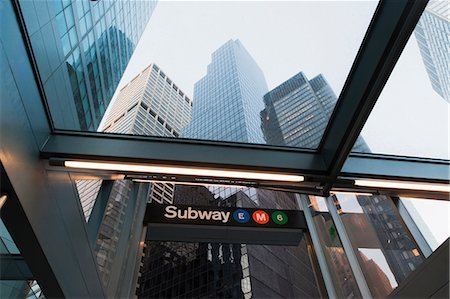 Skyscrapers and subway entrance, New York City, USA Stock Photo - Premium Royalty-Free, Code: 614-06974213