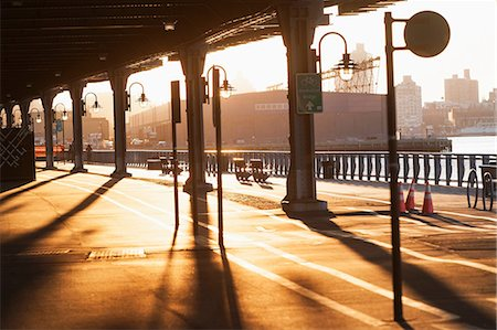 shadow - Cycle and walkway below bridge at sunset  New York City, USA Stock Photo - Premium Royalty-Free, Code: 614-06974235