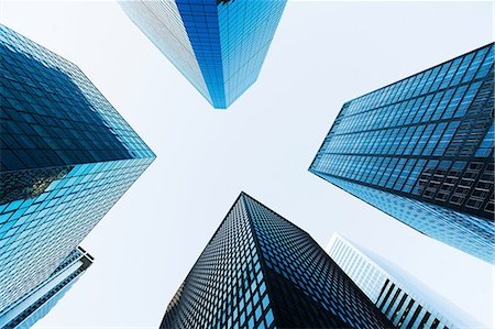 Low angled view of skyscrapers Stock Photo - Premium Royalty-Free, Code: 614-06974239