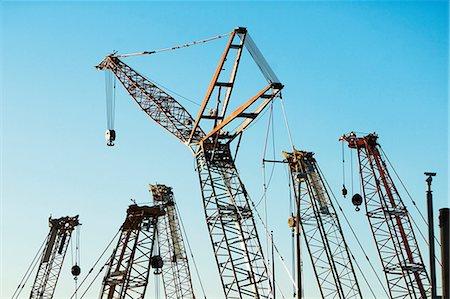 Group of construction cranes Stock Photo - Premium Royalty-Free, Code: 614-06974248