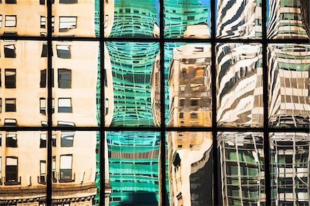 Modern glass facade reflecting varied office buildings Stock Photo - Premium Royalty-Free, Code: 614-06974258