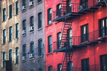 Fire escape and old apartment buildings Stock Photo - Premium Royalty-Free, Code: 614-06974251