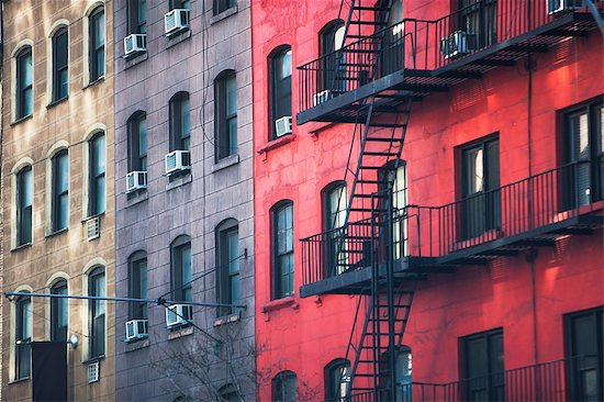 Fire escape and old apartment buildings Stock Photo - Premium Royalty-Free, Image code: 614-06974251