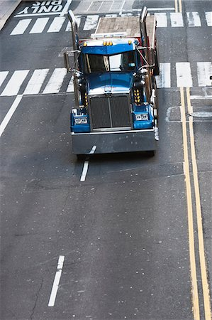 Blue truck driving on city street Stock Photo - Premium Royalty-Free, Code: 614-06974263