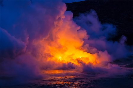 Smoke clouds from lava flow impacting sea at dusk, Kilauea volcano, Hawaii Stock Photo - Premium Royalty-Free, Code: 614-06974284