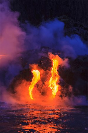 fire - Lava flow impacting sea at dusk, Kilauea volcano, Hawaii Stock Photo - Premium Royalty-Free, Code: 614-06974285