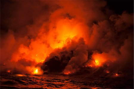 Smoke clouds from lava flow impacting sea at night, Kilauea volcano, Hawaii Stock Photo - Premium Royalty-Free, Code: 614-06974283