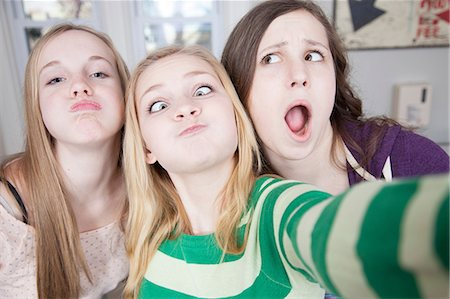 preteen open mouth - Teenagers pulling funny faces Stock Photo - Premium Royalty-Free, Code: 614-06974331
