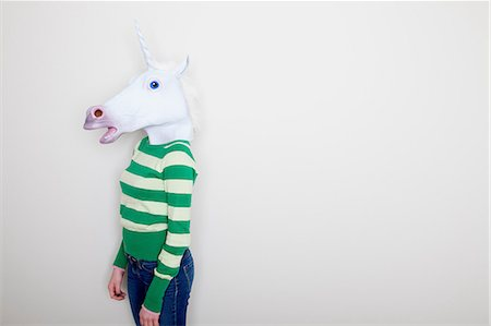 sweater - Girl wearing unicorn head Stock Photo - Premium Royalty-Free, Code: 614-06974353