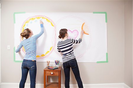 Girls drawing on wall Stock Photo - Premium Royalty-Free, Code: 614-06974383