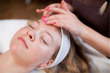 facial - Young woman having facial treatment Stock Photo - Premium Royalty-Free, Code: 614-06974511