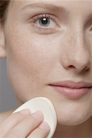 Close up of part of young woman's face, cleansing face Stock Photo - Premium Royalty-Free, Code: 614-06974552