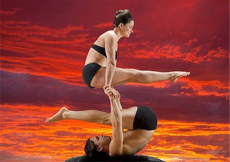 Mid adult dancers performing together at sunset Stock Photo - Premium Royalty-Free, Code: 614-06974606