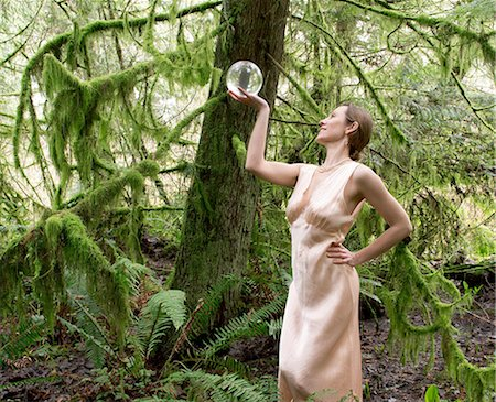 silky - Mature woman looking into crystal ball in forest Stock Photo - Premium Royalty-Free, Code: 614-06974603