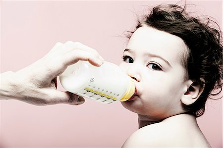 formula - Portrait of baby girl drinking milk from bottle Stock Photo - Premium Royalty-Free, Code: 614-06974699