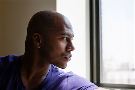 portrait looking away - Close up portrait of mid adult male looking out of window Stock Photo - Premium Royalty-Free, Code: 614-06974760