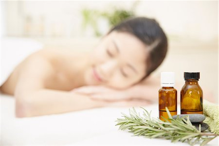 Aromatherapy oils with woman in background Stock Photo - Premium Royalty-Free, Code: 614-06974835