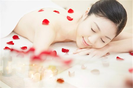 Woman covered in rose petals Stock Photo - Premium Royalty-Free, Code: 614-06974833