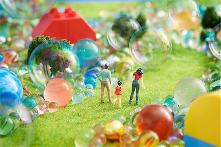 Figurines pretend grass with marbles Stock Photo - Premium Royalty-Free, Code: 614-06974864