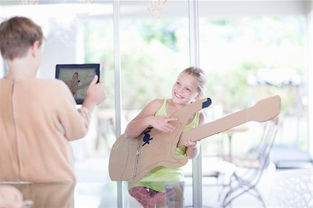 Girl playing the guitar Stock Photo - Premium Royalty-Free, Code: 614-06973537