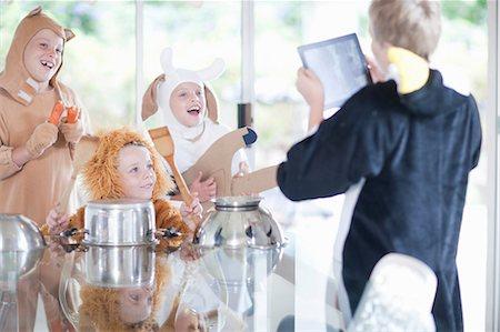 Children pretending to play music instruments Stock Photo - Premium Royalty-Free, Code: 614-06973547