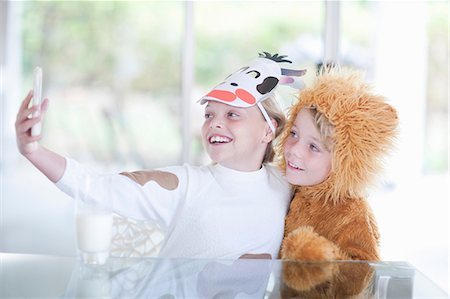 preteen boys playing - Children taking pictures of themselves with smartphone Stock Photo - Premium Royalty-Free, Code: 614-06973543