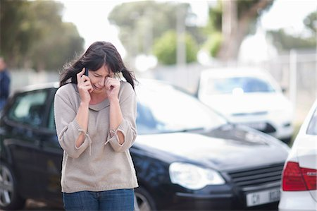 Woman crying after car accident Stock Photo - Premium Royalty-Free, Code: 614-06973593