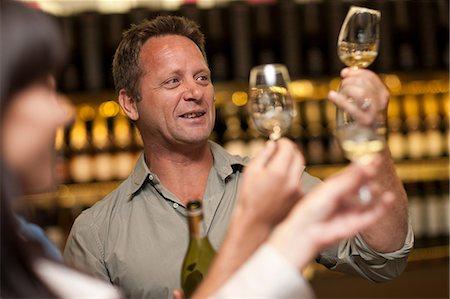 elegant - Wine tasting at wine growers shop Stock Photo - Premium Royalty-Free, Code: 614-06973697