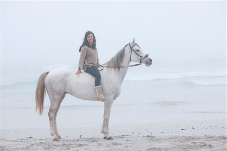 Woman riding horse on beach Stock Photo - Premium Royalty-Free, Code: 614-06973724