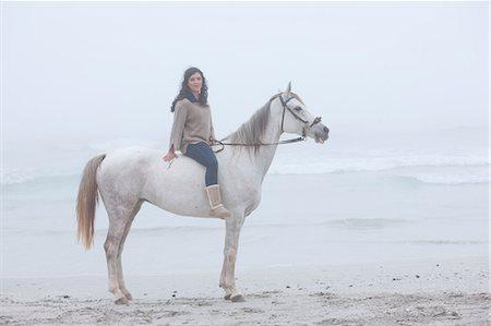 Woman riding horse on beach Stock Photo - Premium Royalty-Free, Code: 614-06973724
