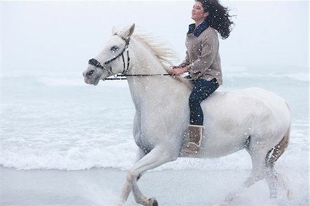 Woman riding horse on beach Stock Photo - Premium Royalty-Free, Code: 614-06973729