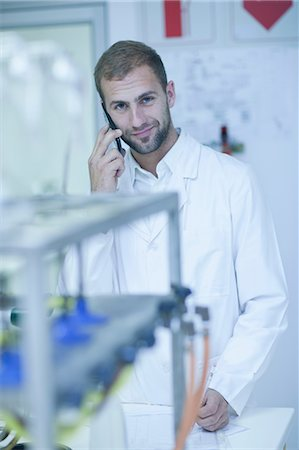 formula - Oenologist on cellular phone Stock Photo - Premium Royalty-Free, Code: 614-06973721