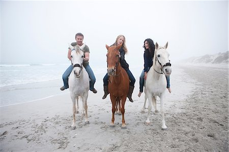 People riding horse on beach Stock Photo - Premium Royalty-Free, Code: 614-06973736