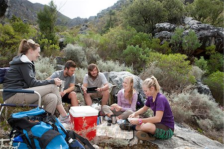 rock - Group of young hikers taking a break Stock Photo - Premium Royalty-Free, Code: 614-06973776