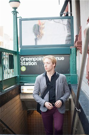 sign - Young man emerging from subway station Brooklyn, New York City, USA Stock Photo - Premium Royalty-Free, Code: 614-07031093