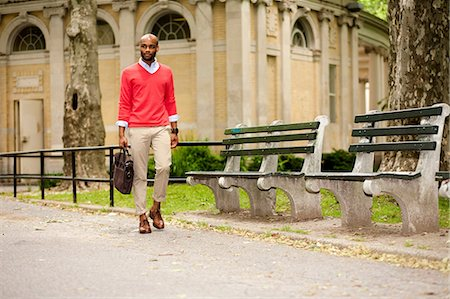 style - Young man carrying briefcase through park Stock Photo - Premium Royalty-Free, Code: 614-07031109
