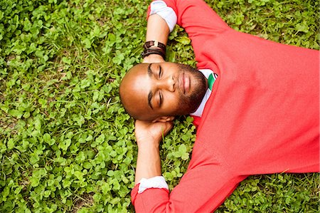 funky - Portrait of young man lying on grass Stock Photo - Premium Royalty-Free, Code: 614-07031112