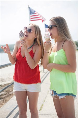 Young women eating ice cream at beach Stock Photo - Premium Royalty-Free, Code: 614-07031128